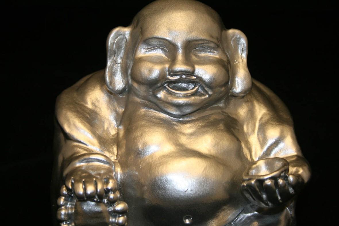 Custom clay sculpture of a silver Buddha made by Ciyo