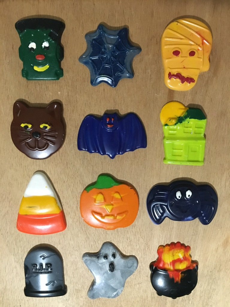 Frankenstein, spiderweb, mummy, cat, bat, haunted house, candy corn, pumpkin, spider, tombstone, ghost and cauldron Halloween crayons